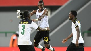 (L-R) Ghana's forward Asamoah Gyan, Ghana's defender Harrison Afful and Ghana's defender Daniel Amartey celebrate at the end of the 2017 Africa Cup of Nations group D football match between Ghana and Mali in Port-Gentil on January 21, 2017.  Justin TALLIS / AFP