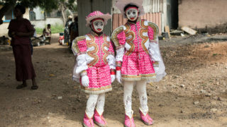 Affuah Appiawah Sey and her cousin poses during the Winneba Fancy Dress, known locally as Kakamotobi, on January 2, 2017, in the coastal town of Winneba.  The Fancy Dress festival which began in the 19th century by British and Dutch traders, is a masquerade festival held on Christmas to the first day of January every year by the people of Winneba. / AFP PHOTO / Ruth McDowall