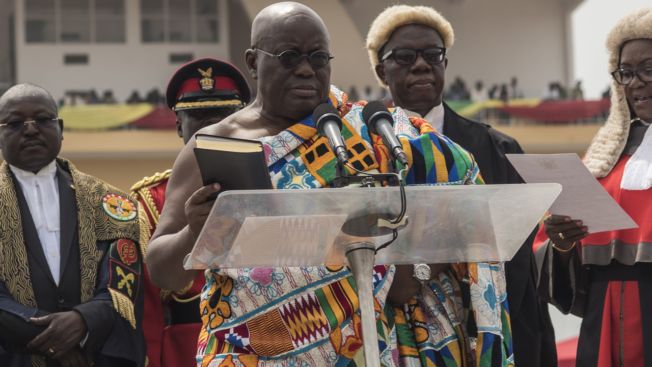 The winner of Ghana's presidential election Nana Akufo-Addo (C) takes the oath of office during the swearing-in as elected President of the fourth Republic of Ghana, in Independence Square in the capital Accra, on January 7, 2017. The 72-year-old former human rights lawyer took the oath of office in front of more than 6,000 guests and a roaring crowd. The new president underlined his campaign promise to support entrepreneurs and attract investors to the country, which has suffered from lacklustre growth in recent years. / AFP PHOTO / CRISTINA ALDEHUELA