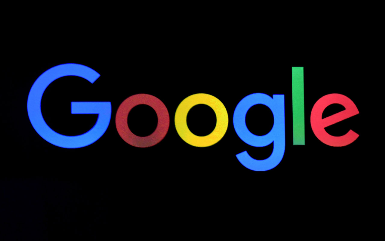 A Google logo is shown on a screen/  Ethan Miller/Getty Images/AFP