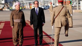 French President Francois Hollande (R) and Iraqi Kurdish leader Massud Barzani (L) attend a ceremony in the International Airport of Arbil, the capital of the Kurdish autonomous region in northern Iraq, on January 2, 2017. Western support for military action against Islamic State jihadists is key to preventing attacks at home, and the Mosul battle could be won 'before summer' French President Francois Hollande said in Iraq, where yet another bombing killed dozens. Christophe Ena / POOL / AFP