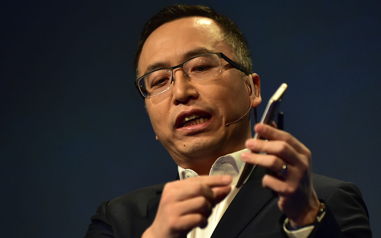 George Zhao, president of Honor, a division of Huawei, speaks while holding the newly introduced Honor 6X phone during the company's press conference at the 2017 Consumer Electronics Show (CES2017) in Las Vegas, Nevada, on January 3, 2017. / AFP PHOTO / Frederic J. BROWN