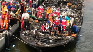 Rescuers search the charred passenger boat which was ferrying around 200 people off the coast of Jakarta to Tidung island, a tourist destination 50 kilometres (30 miles) from the capital when a fire started on January 1, 2017. At least 23 people have been killed and 17 are missing after a passenger boat caught fire near Jakarta, according to officials.  DYAHFRAGMA / AFP