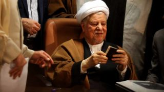 (FILES) This file photo taken on December 21, 2015 shows Iranian former president and head of the Expediency Council, Akbar Hashemi Rafsanjani showing his ID as he registers his candidacy for the upcoming Assembly of Experts elections at the interior ministry in Tehran. Former Iranian president Rafsanjani dead: agencies  ATTA KENARE / AFP