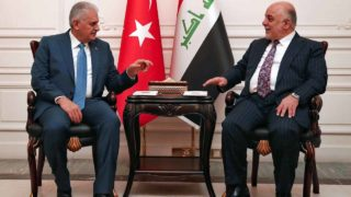 This handout photo provided by the Turkish Prime Minister's Press Office shows Turkish Prime Minister Binali Yildirim (L) and Iraqi Prime Minister Haider al-Abadi (R) speaking during a meeting at the governmental palace in Baghdad on January 7, 2017.  HAKAN GOKTEPE / TURKISH PRIME MINISTER PRESS OFFICE / AFP
