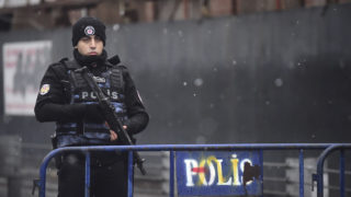 A Turkish police officer stands guard close to the site of an armed attack near the Reina night club, one of the Istanbul's most exclusive party spots, early on January 1, 2017 after at least one gunmen went on a shooting rampage during New Year's Eve celebrations. Thirty-nine people, including many foreigners, were killed when a gunman reportedly dressed as Santa Claus stormed an Istanbul nightclub as revellers were celebrating the New Year, the latest carnage to rock Turkey after a bloody 2016. / AFP PHOTO / YASIN AKGUL