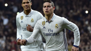 Real Madrid's Colombian midfielder James Rodriguez (R) celebrates past Real Madrid's French defender Raphael Varane after scoring on a penalty kick during the Spanish Copa del Rey (King's Cup) round of 16 first leg football match Real Madrid CF vs Sevilla FC at the Santiago Bernabeu stadium in Madrid on January 4, 2017. / AFP PHOTO / GERARD JULIEN