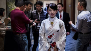 """Humanoid robot Jia Jia, created by a team of engineers from the University of Science and Technology of China, is seen following a presentation at a conference in Shanghai on January 9, 2017. """"Jia Jia"""" can hold a simple conversation and make specific facial expressions when asked, and her creator believes the eerily life-like robot heralds a future of cyborg labour in China. Billed as China's first human-like robot, Jia Jia was first trotted out last year by a team of engineers at the University of Science and Technology of China.  / AFP PHOTO / Johannes EISELE"""