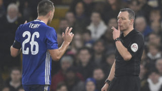 Chelsea's English defender John Terry (L) reacts just before Kevin Friend shows him a red card after a challenge on Peterborough United's English striker Lee Angol during the English FA Cup third round football match between Chelsea and Peterborough at Stamford Bridge in London on January 8, 2017. / AFP PHOTO / Glyn KIRK /
