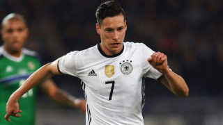 Germany's midfielder Julian Draxler playing during the WC 2018 football qualification match between Germany and Northern Ireland.  German international Julian Draxler has joined Paris Saint Germain from Wolfsburg, the French club said on January 3, 2017.  / AFP PHOTO / Patrik STOLLARZ