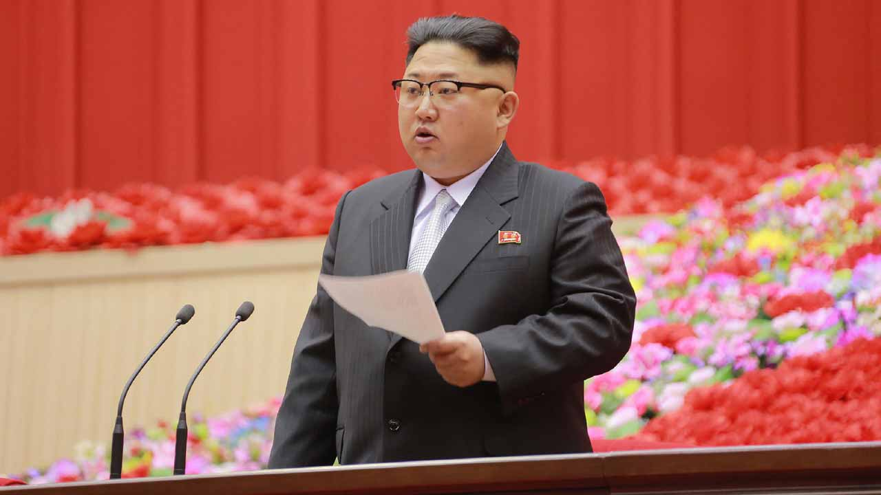 This picture released on December 26, 2016 from North Korea's official Korean Central News Agency (KCNA) shows North Korean leader Kim Jong-Un (C) delivering a speech at the First Conference of Chairpersons of the Primary Committees of the Workers' Party of Korea (WPK) at Pyongyang Indoor Stadium in Pyongyang. STR / KCNA VIA KNS / AFP
