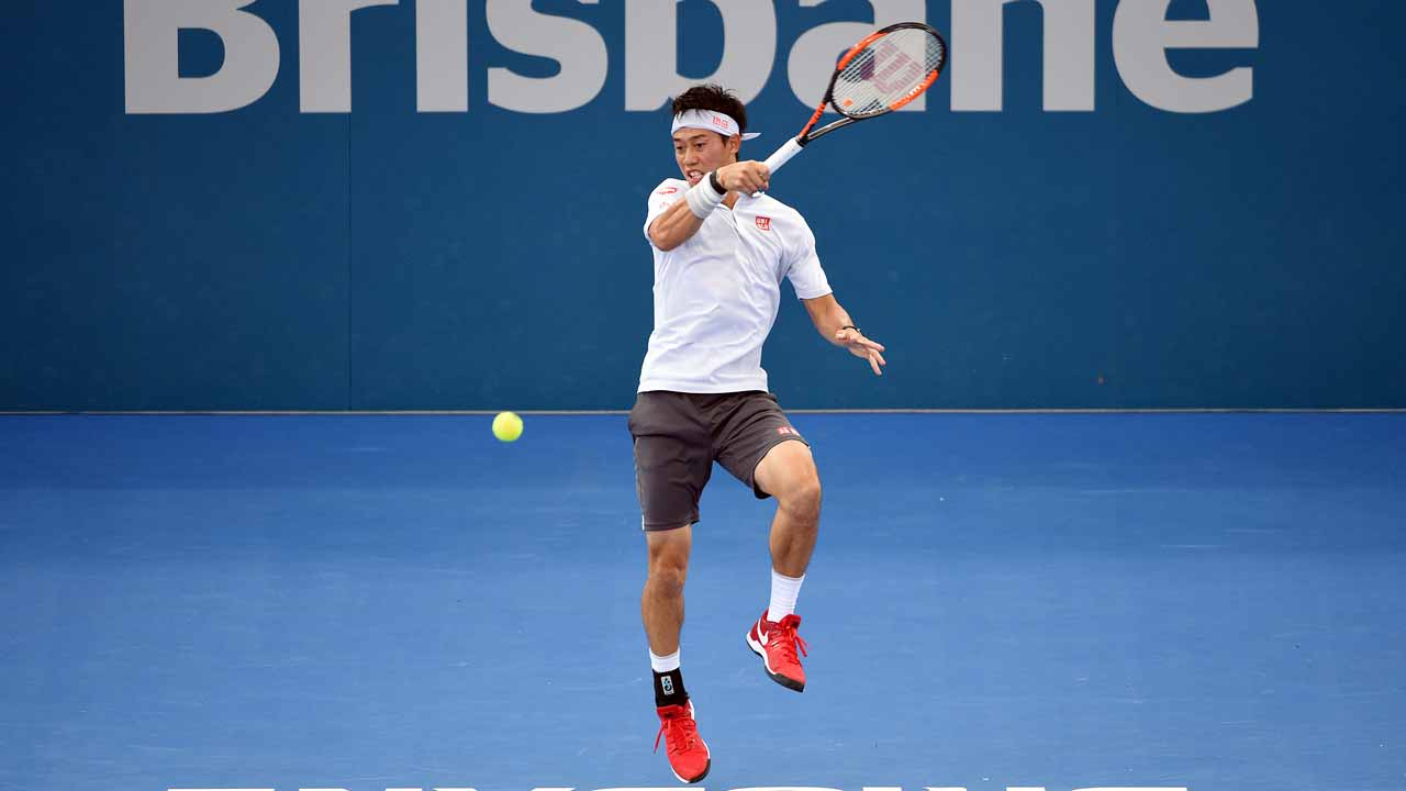 Japan's Kei Nishikori hits a return against Jared Donaldson of the US in their men's second round match at the Brisbane International tennis tournament in Brisbane on January 4, 2017. Saeed KHAN / AFP