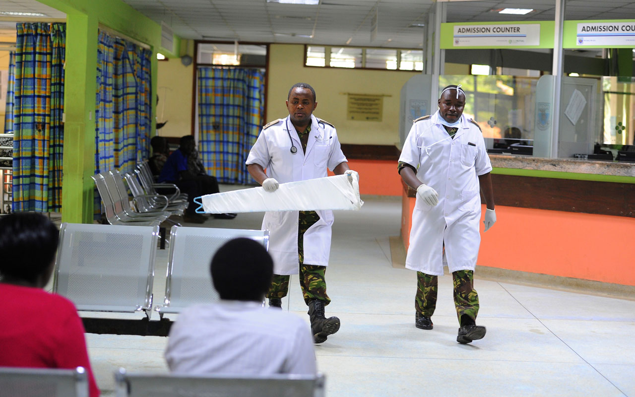 (FILES) This file photo taken on December 10, 2016 shows Kenyan Defence force {KDF} Doctors walking inside Kenyatta National Hospital, on December, 10,2016, in Nairobi, after Kenya deployed army doctors to the country's main teaching and referral hospital where the last remaining doctors joined a five-day strike. Kenyan doctors on January 6, 2017 rejected government's offer of a 40 percent pay rise in the latest bid to end a month-long strike that has crippled public hospitals across the country.Thousands of doctors in the country downed tools on December 5 to demand a 300 percent pay rise that they say was agreed in a 2013 collective bargaining agreement (CBA), and several rounds of negotiations have failed as the medics dig their heels in. / AFP PHOTO / JOHN MUCHUCHA