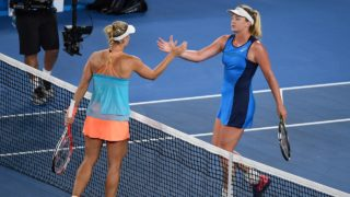 Coco Vandeweghe of the US (R) shakes hands with Germany's Angelique Kerber following Vandeweghe's victory in their women's singles fourth round match on day seven of the Australian Open tennis tournament in Melbourne early on January 23, 2017.  WILLIAM WEST / AFP