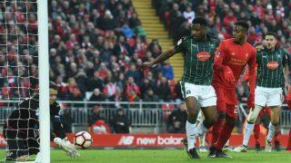 Plymouth's English goalkeeper Luke McCormick makes a late save during the English FA Cup third round football match between Liverpool and Plymouth Argyle at Anfield in Liverpool, north west England on January 8, 2017. The game finished 0-0. Paul ELLIS / AFP
