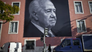 Big pictures of the historic socialist leader and former Portuguese President Mario Soares are displayed on a facade of the Portuguese Socialist party headquarters in Lisbon on January 8, 2017, one day after his death.  Mario Soares, widely seen as the father of Portugal's modern-day democracy, was a towering figure in the country's political scene who spearheaded its entry into the European Union. Soares, the founder of Portugal's Socialist party who died on January 7, 2017 at the age of 92, spent decades in politics, serving as foreign minister, prime minister and president as well as a European lawmaker.  / AFP PHOTO / PATRICIA DE MELO MOREIRA