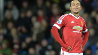Manchester United's Dutch midfielder Memphis Depay reacts after miss-hitting a cross during the English Premier League football match between Manchester United and Watford at Old Trafford in Manchester in north west England on March 2, 2016. Manchester United have agreed to sell Dutch winger Memphis Depay to Lyon for a fee that could reach around 25 million euros ($26.7 million), British media reported on January 18, 2017. / AFP PHOTO / OLI SCARFF /