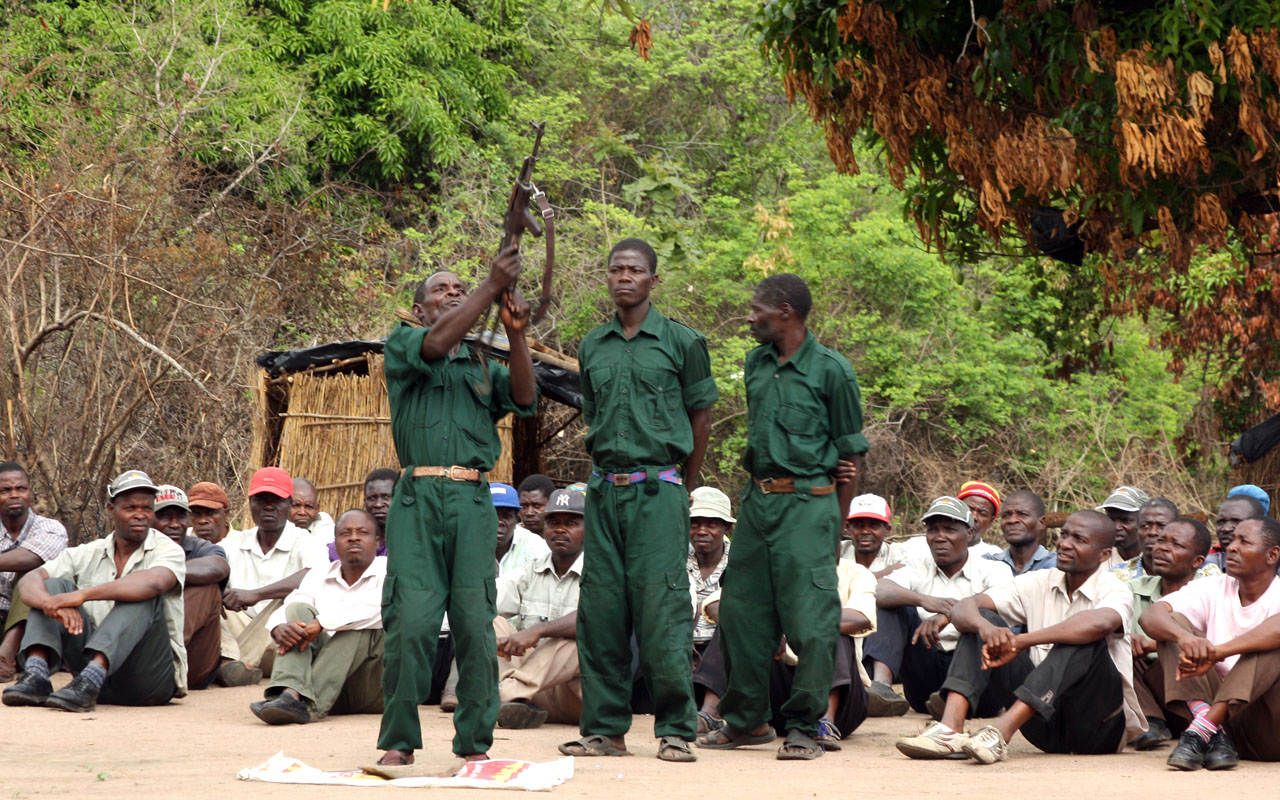 "fighters of the former Mozambican rebel movement ""Renamo"" receiving military training in Gorongosa's mountains, Mozambique. Mozambican rebel leader Afonso Dhlakama announced on January 3, 2017 a two-month ceasefire in the rumbling conflict between Renamo and the government, extending a week-long truce in a move welcomed by the president. ""There have been some minor incidents, but the seven-day truce went well, so I announce the extension of the truce for 60 days, until March 4,"" Dhlakama said in a telephone press conference. / AFP PHOTO / Jinty Jackson"