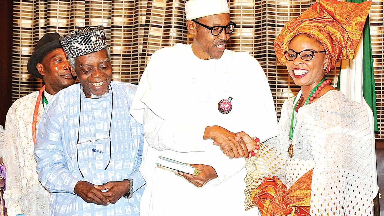 An awardee, Prof. Tanure Ojaide; Chairman National Merit Award Committee Prof. Etim Moses Essien; President Muhammadu Buhari; and an awardee, Prof. Omowunmi Sadik during the 2016 awardees' visit to the president at the Presidential Villa, Abuja… yesterday  PHOTO:PHILIP OJISUA