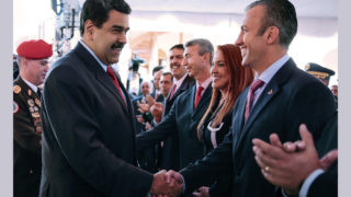 """Handout picture released by the Venezuelan presidency showing President Nicolas Maduro (L) greeting new Vice-President Tareck El Aissami in Caracas on January 4, 2017.  Maduro on January 4, 2017 named Tareck El Aissami as his new vice-president, who would take over from him if he were removed from office this year as the opposition demands. Maduro said in a televised address that he had named El Aissami, 47, a powerful state governor, to the post for the 2017 to 2018 period. / AFP PHOTO / Venezuelan Presidency / HO / RESTRICTED TO EDITORIAL USE - MANDATORY CREDIT """"AFP PHOTO / VENEZUELAN PRESIDENCY / HO"""""""