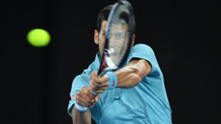 Serbia's Novak Djokovic hits a return against Spain's Fernando Verdasco during their men's singles match on day two of the Australian Open tennis tournament in Melbourne on January 17, 2017. / AFP PHOTO / GREG WOOD /