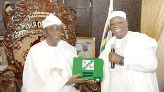 President Pharmaceutical Association of Nigeria (PSN), Ahmed I. Yakasai (right), presenting a First Aid Tool Box to Oba of Lagos, Oba Rilwan Akiolu, during a courtesy visit on Monday January 16, 2017