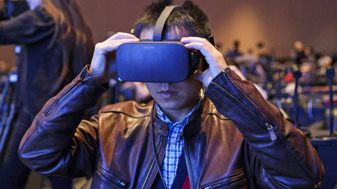 Attendees wear Oculus Rift virtual reality at CES 2017. Photographer: Patrick T. Fallon/Bloomberg
