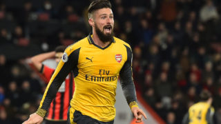 Arsenal's French striker Olivier Giroud celebrates after scoring their third goal during the English Premier League football match between Bournemouth and Arsenal at the Vitality Stadium in Bournemouth, southern England on January 3, 2017. The game finished 3-3. / AFP PHOTO / Glyn KIRK /