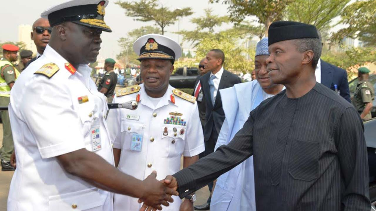 "Acting President, Yemi Osinbajo (right); Chief of Naval Staff, Vice Admiral Ibok Ekwe Ibas and    Commandant, National Defence College, Real Admiral Samuel Ilesanmi Alade; during Osinbajo's arrival at the college for the public presentation on  ""Harmonised standard operating procedures on arrest, detention and prosecution of vessels and persons in Nigeria's maritime environment"" in Abuja. PHOTO: PHILIP OJISUA"