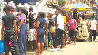 Commercial  activities picks up after the Yuletide on Post Office Road, Oshodi, Lagos… yesterday.                   PHOTO: AYODELE ADENIRAN