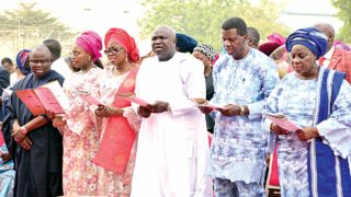 Lagos State Governor Akinwunmi Ambode (middle), his wife, Bolanle (third left), Senator Olamilekan Solomon Adeola (left), his wife, Temitope (2nd left), Spiritual Leader and Global Missioner of The Redeemed Christian Church of God, Pastor Enoch Adeboye (second right) and his wife, Pastor Folu Adeboye (right) at the 2017 yearly thanksgiving service at the Lagos House, Ikeja…yesterday