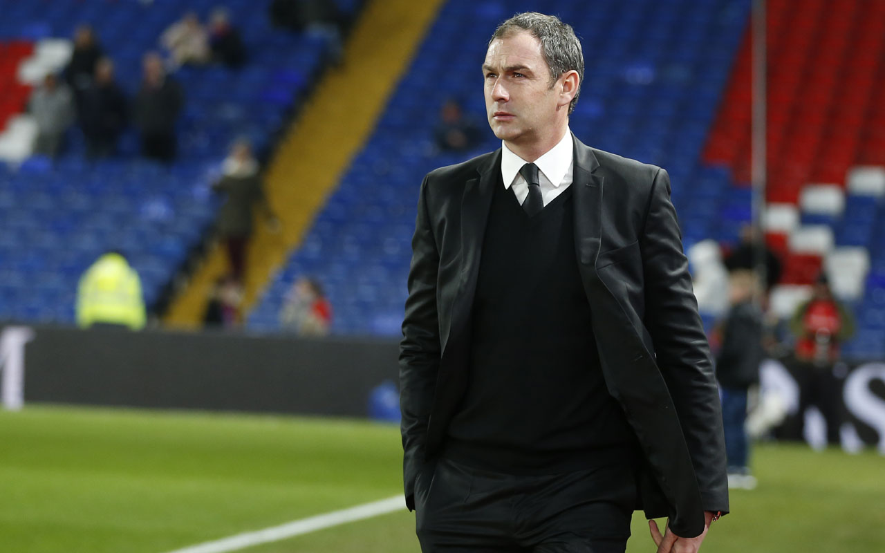Swansea City's new English head coach Paul Clement checks out the conditions ahead of the English Premier League football match between Crystal Palace and Swansea City at Selhurst Park in south London on January 3, 2017. Paul Clement became Premier League bottom side Swansea's third manager this season when he was appointed on Tuesday, January 3, 2017. Clement, whose only previous job as a manager was with second tier Derby, will attend Tuesday's relegation clash with Crystal Palace but watch from the stands as first team coach Alan Curtis will take charge. / AFP PHOTO / Ian KINGTON /
