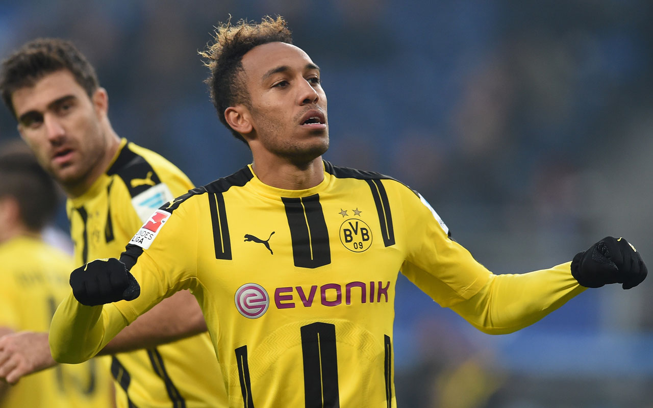 Pierre-Emerick Aubameyang from Dortmund celebrating his fourth goal during the German first division Bundesliga football match between Hamburg SV and BVB Borussia Dortmund in Hamburg, northern Germany German Bundesliga club Dortmund denied on January 4, 2017 a rumor circulating on Internet that the Chinese club of Shanghai SIPG made a record offer for Aubameyang of 150 million euros. / AFP PHOTO / CARMEN JASPERSEN