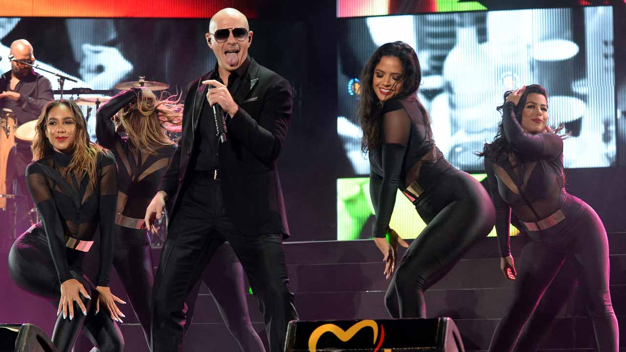 "(FILES) This file photo taken on May 27, 2016 shows US singer Pitbull performs during the World Music Festival ""Mawazine"" in Rabat. US rapper Pitbull's $1 million contract to promote tourism in Florida, including his video with swimsuit-clad women frolicking on beaches, unleashed a political scandal that has toppled the state's tourism chief. Visit Florida, the state tourism marketing agency that is funded by taxpayers, confirmed January 11, 2017 to AFP that its chief executive Will Seccombe had agreed to a $73,000 severance. FADEL SENNA / AFP"