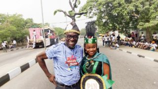 Poets in Nigeria (PIN) chairman, Eriata Oribhabor and a member at the Calabar Christmas Carnival train