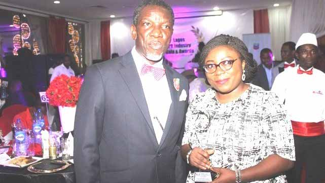 Chairman, Nigerian Institute of Public Relations (NIPR), Lagos State Chapter, Olusegun McMedal with Assistant Brand Manager, Promasidor Nigeria Limited, Oluwatooni Odewole, holding Promasidor's Best Company in Education award during the 2016 Lagos PR Industry Gala and Awards (LaPRIGA) organised by Lagos State Chapter of NIPR… in Lagos