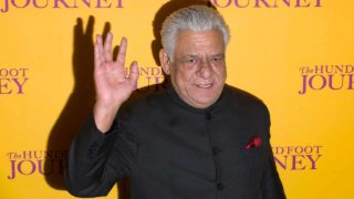 (FILES) This file photograph taken on September 3, 2014, shows Indian Bollywood actor Om Puri waving as he attends the UK Gala Screening of the film, The Hundred Foot Journey, in central London. Acclaimed Indian actor Om Puri, well-known abroad for his role in hit movie Gandhi, has died aged 66 after suffering a heart attack on January 6, 2016, reports said. JUSTIN TALLIS / AFP