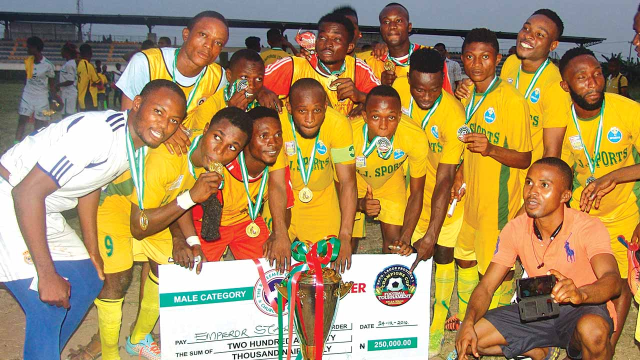 Winners of the RCCG competition, Emperor Stars Football Club, with the cup and cheque won. PHOTO: ISAAC TAIWO
