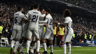 Real Madrid's Colombian midfielder James Rodriguez (C) is congratulated by his teammates after scoring on a penalty kick during the Spanish Copa del Rey (King's Cup) round of 16 first leg football match Real Madrid CF vs Sevilla FC at the Santiago Bernabeu stadium in Madrid on January 4, 2017. / AFP PHOTO / GERARD JULIEN