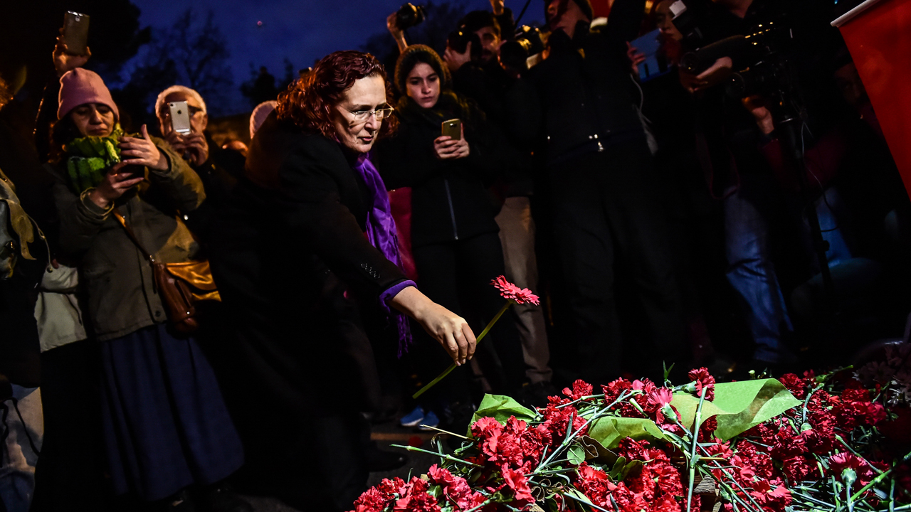 People lay flowers in front of the Reina nightclub on January 3, 2017 in Istanbul days after a gunman killed 39 people during New Year celebrations. The gunman who killed 39 people at an Istanbul nightclub had fought in Syria for Islamic State jihadists, a report said on January 3, as Turkish authorities intensified their hunt for the attacker. Of the 39 dead, 27 were foreigners, mainly from Arab countries, with coffins repatriated overnight to countries including Lebanon and Saudi Arabia. / AFP PHOTO / YASIN AKGUL
