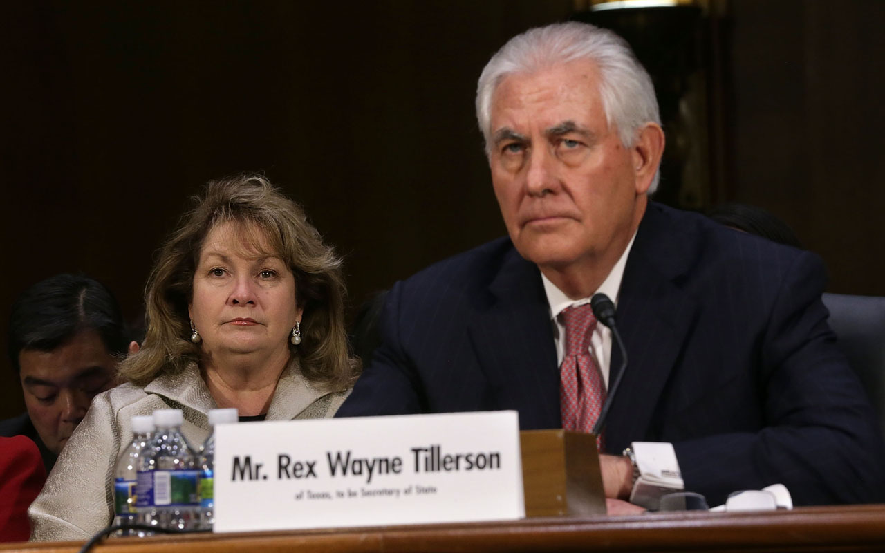 WASHINGTON, DC - JANUARY 11: Renda Tillerson (L) listens during the confirmation hearing for her husband and former ExxonMobil CEO Rex Tillerson (R), U.S. President-elect Donald Trump's nominee for Secretary of State, before Senate Foreign Relations Committee January 11, 2017 on Capitol Hill in Washington, DC. Tillerson is expected to face tough questions regarding his ties with Russian President Vladimir Putin. Alex Wong/Getty Images/AFP