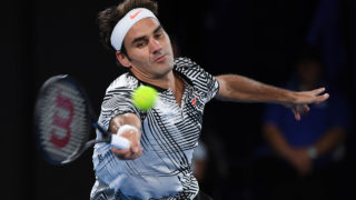 Switzerland's Roger Federer hits a return against Czech Republic's Tomas Berdych during their men's singles third round match on day five of the Australian Open tennis tournament in Melbourne on January 20, 2017. / AFP PHOTO / WILLIAM WEST /