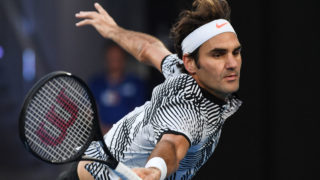 Switzerland's Roger Federer hits a return against Germany's Mischa Zverev during their men's singles quarter-final match on day nine of the Australian Open tennis tournament in Melbourne on January 24, 2017. / AFP PHOTO / SAEED KHAN /