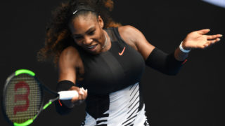 Serena Williams of the US hits a return against Switzerland's Belinda Bencic during their women's singles match on day two of the Australian Open tennis tournament in Melbourne on January 17, 2017. / AFP PHOTO / GREG WOOD /