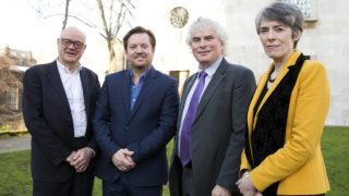 The London Symphony Orchestra's Music Director Designate, Simon Rattle (2R), poses for a photograph alongside London Symphony Orchestra Chairman Gareth Davies (2L), London Symphony Orchestra Managing Director Kathryn McDowell (R), and Barbican Centre Managing Director Nicholas Kenyon, following a press conference in London on January 17, 2017, where he announced plans for his opening season and future plans of the orchestra.  Isabel INFANTES / AFP