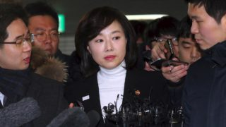 South Korea's Culture Minister Cho Yoon-Sun (C) arrives to be questioned at the office of the independent counsel on a corruption scandal case that led to the impeachment of President Park Geun-Hye in Seoul on January 17, 2017. South Korea's culture minister Cho was questioned by prosecutors on January 17 over allegations that the government blacklisted thousands of artists for their political beliefs, the first incumbent cabinet minister to be formally interviewed in the scandal surrounding Park. STR / YONHAP / AFP
