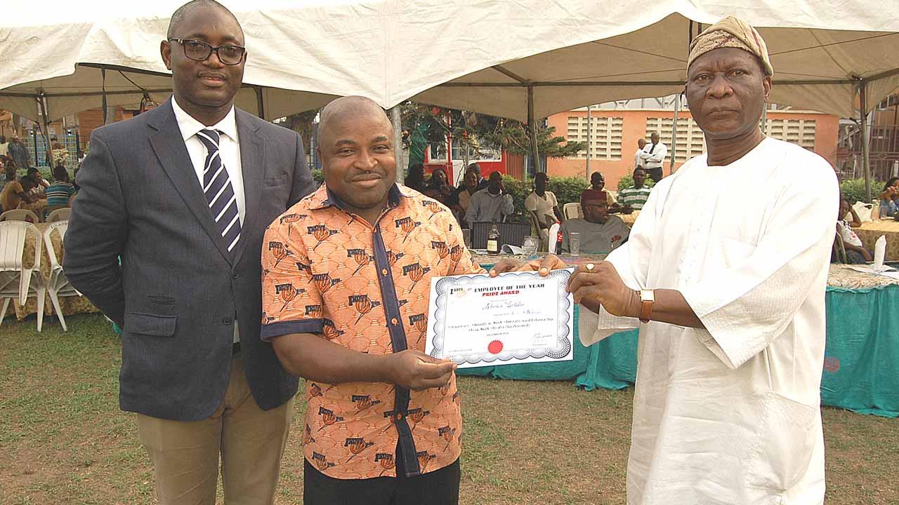 General Manager, Ikoyi Club 1938, Mr. Babatunde Orungbeja (left); Best Supervisor of the Year, Mr. Abiodun Yakubu and the Club Chairman, Major Gen. Mufutau Balogun (Rtd), at the party.