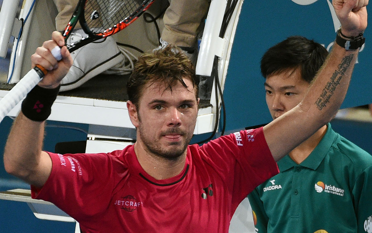 Stan Wawrinka of Switzerland celebrates his victory against Viktor Troicki of Serbia in the men's second round at the Brisbane International tennis tournament in Brisbane on January 4, 2017. / AFP PHOTO / SAEED KHAN / IMAGE
