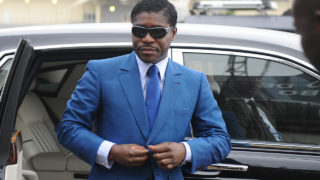 "(FILES) This file photo taken on June 24, 2013 shows  Teodoro (aka Teodorin) Nguema Obiang Mongue, the son of Equatorial Guinea's president, arriving at Malabo stadium for ceremonies to celebrate his 41st birthday. Obiang will go on trial in a Paris court on January 2, 2017 in a case of ""ill-gotten gains"". / AFP PHOTO / JEROME LEROY"