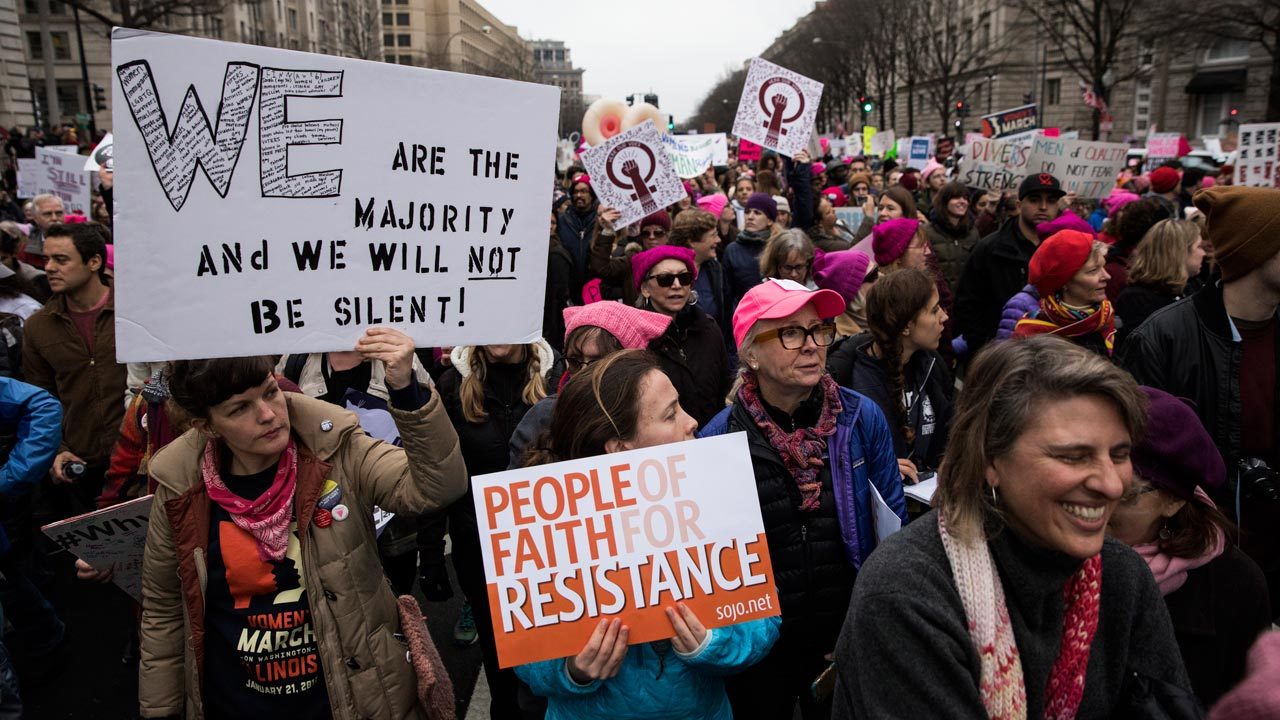Demonstrators march down Pennsylvania Avenue during the Women's March on Washington January 21, 2017 in Washington, DC. Hundreds of thousands of protesters spearheaded by women's rights groups demonstrated across the US to send a defiant message to US President Donald Trump. ZACH GIBSON / AFP